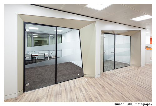Faceted meeting rooms help break down the standard cellular feeling of such spaces