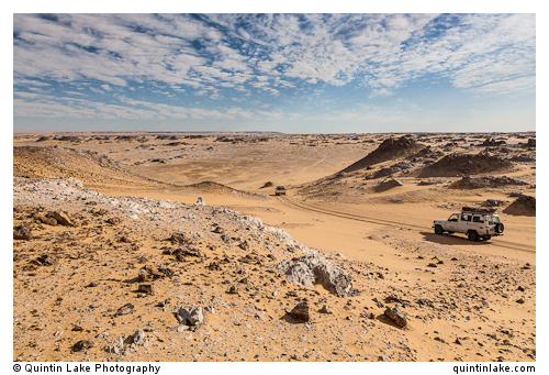 Landcruisers descend into a wadi in the Sahara Suda (Black Desert), Egypt
