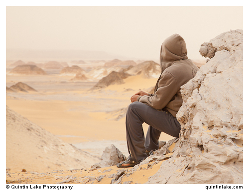 A beduin guide, Mahmood contemplating the White Desert, Egypt