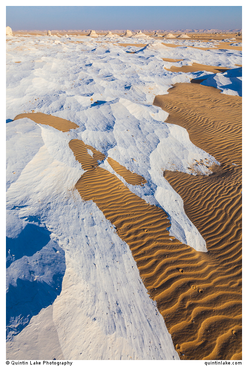 Wind sculpted chalk waves and sand in the Sahara Beida (White De