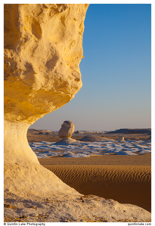 Chalk sculptures catch the setting sunlight in the White Desert, Egypt