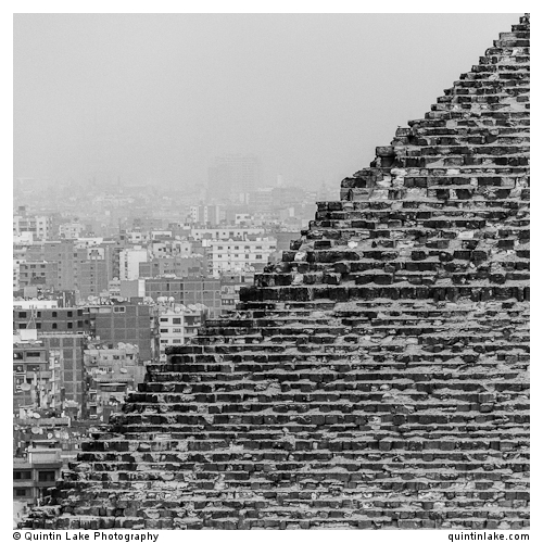 Great Pyramid of Giza in front of modern skyline of Cairo
