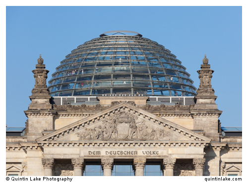 New dome above the inscription: Dem deutschen Volke, meaning To the German people, on the architrave of the Reichstag Building