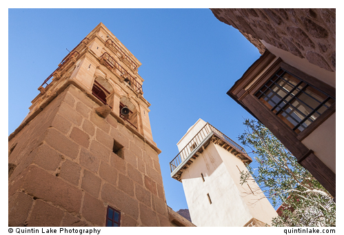 Bell tower (left) & Mosque Minaret (right) inside courtyard