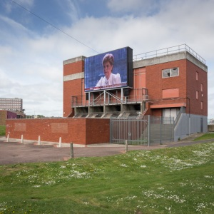 Election Aftermath. Nicola Sturgeon, leader of the SNP after her landslide victory in Scotland, winning 56 out of 59 seats. Chatham Big Screen on the old pumping station at Chatham Waterfront.