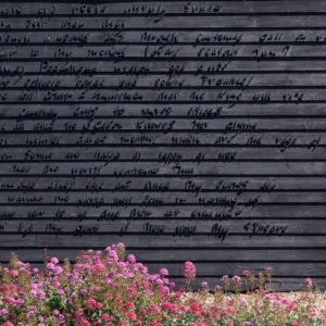 The Sunne Rising by John Donne on the side of Prospect Cottage, Dungeness.
