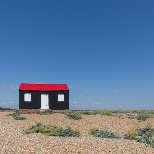 Beach hut with red roof, Rye Harbour, Sussex.