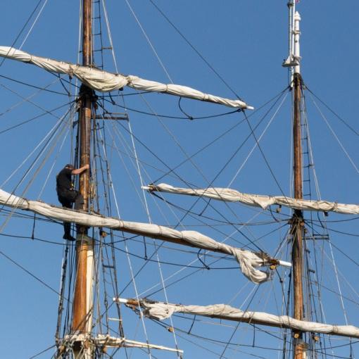 Climbing the mast, Gunwharf Quays, Portsmouth, Hampshire.