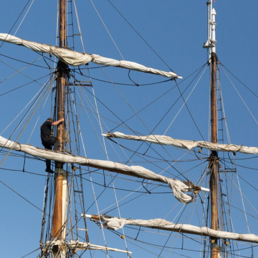 Climbing the mast, Gunwharf Quays, Portsmouth, Hampshire.