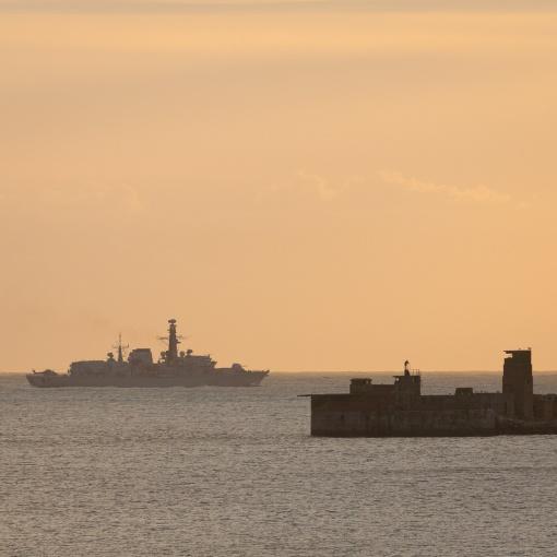 Frigate HMS Monmouth passes Portland Harbour Breakwater, Dorset.