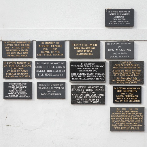 Plaques of remembrance for sailors lost at sea, Sutton Harbour, Plymouth, Devon.