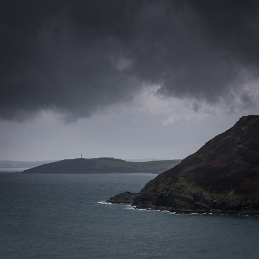 Rain clouds over Gribbin Head & Blackbottle Rock, Cornwall.