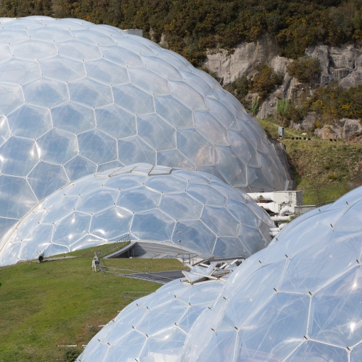 Biomes and grass roofed link building, Eden Project, Cornwall.