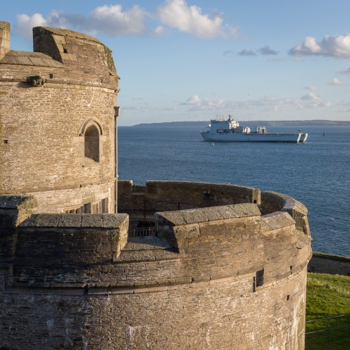St Mawes Castle (built 1542) and RFA Lyme Bay, Cornwall.