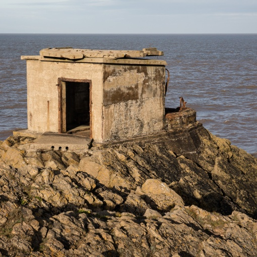 WW2 searchlight position with roof folded back on itself by wave action, Brean Down Fort, Somerset.
