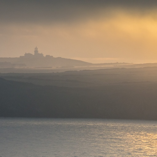Sunrise over Caldey Island lighthouse, Dyfed.