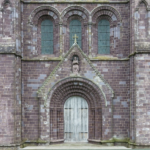 West front of St David's Cathedral made of distinctive purple Cambrian sandstone, Pembrokeshire.